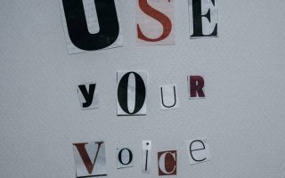 use your voice inscription on gray background